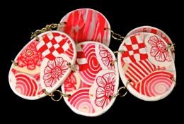Obrázek výrobku: Růžovobílé skládané ovály - náramek
